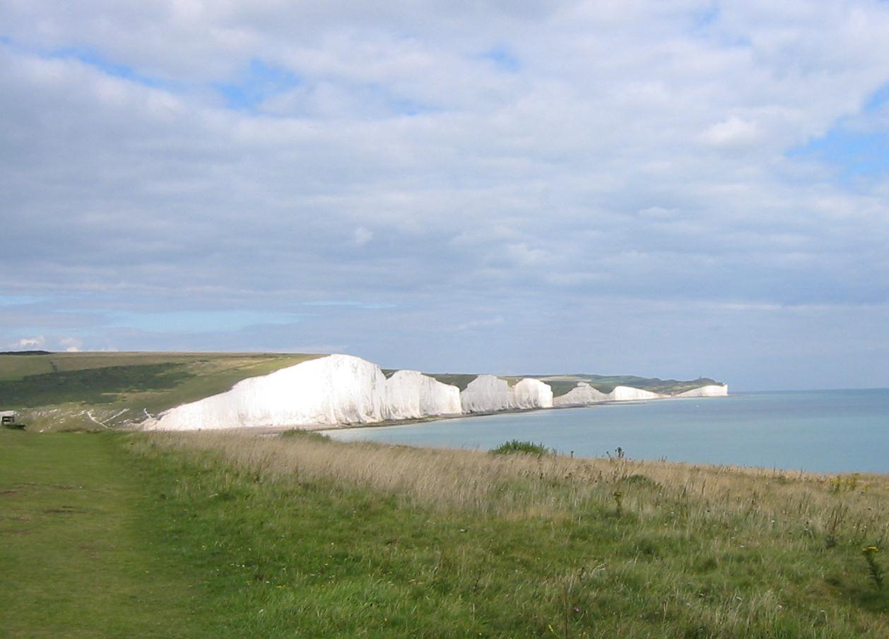 the Vanguard Way heads for Newhaven the spectacular prospect behind the walker  includes the famous Seven Sisters